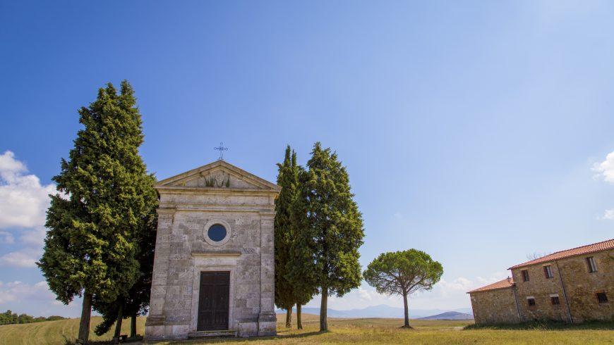 Chapel of the Madonna di Vitaleta among cypresses