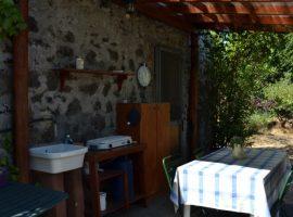 Outdoor kitchen at straw bale house felcerossa
