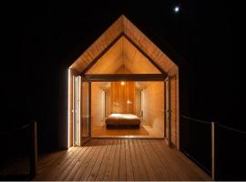 Bigger wooden house for glamping in Kamp Koren