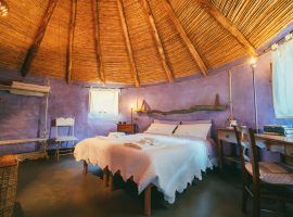 Purple room in the Essenza Sardegna