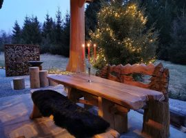 Charming wooden table on the courtyard of Divjake Log Home