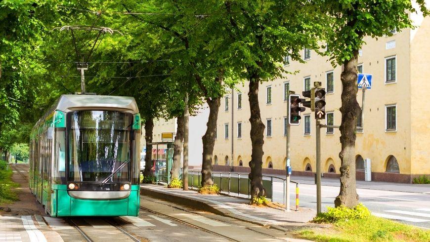 modern green tram in Helsinki, Finland