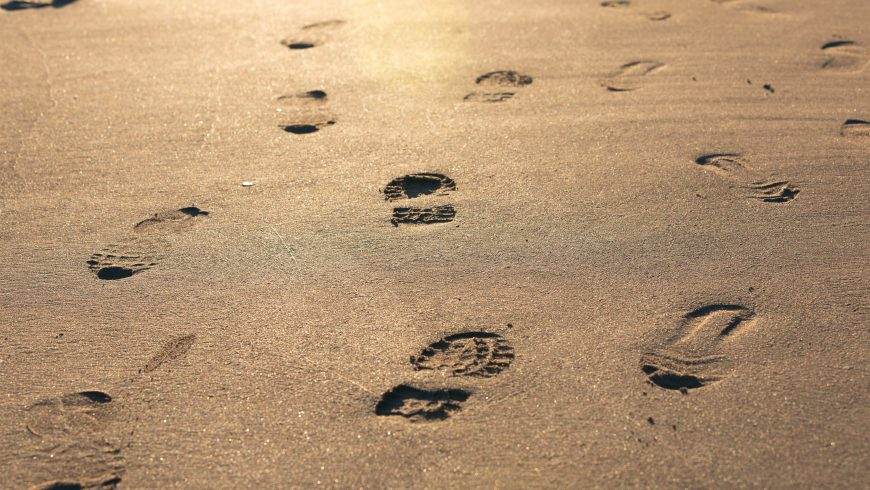 footprints on the sand, a metaphor of carbon footprint