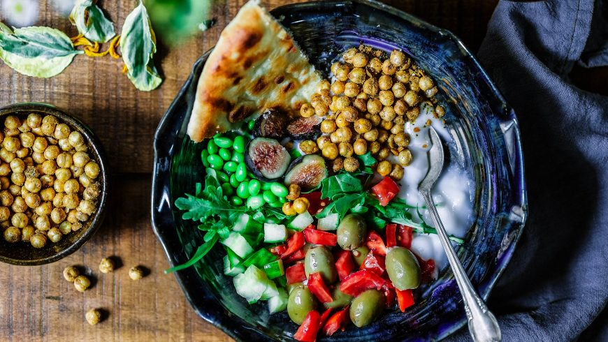 Vegan salad with chickpeas, olives and tomatoes