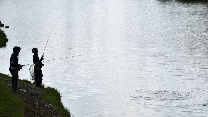 People fishing at lake Nembia