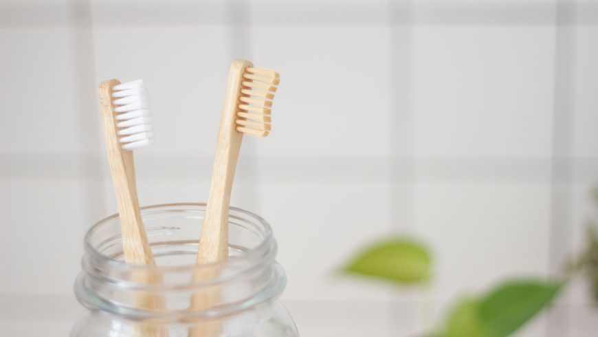Two eco toothbrushes in a mason jar.