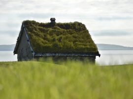 Stone house with a green roof